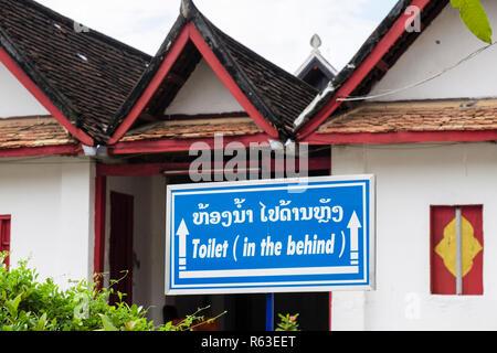 Amusing translation of Lao language in to English on toilet sign in Wat Mai Suwannaphumaham temple complex. Luang Prabang, Louangphabang, Laos, Asia - Stock Image