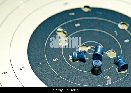 Airgun Ammunition With Target Paper - Stock Image