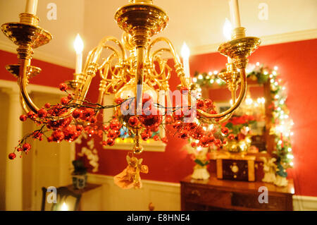Interior of a home decorated for a traditional Christmas. - Stock Image