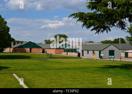 View across the lawns to Huts 3 and 6 in red brick, at Bletchley Park, Milton Keynes, Buckinghamshire, UK - Stock Image