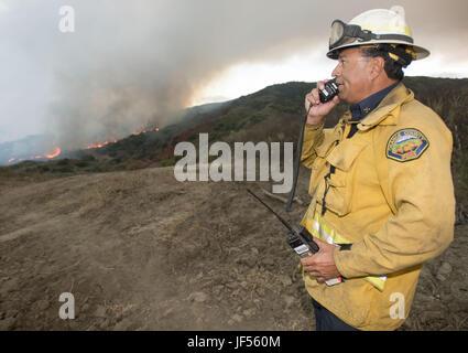 June 28, 2017 - San Clemente, California, U.S - Orange County Fire Authority Battalion Chief POKEY SANCHEZ organizes - Stock Image