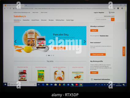 Computer screen showing Sainsburies on-line shopping web site with a feature on pancake day - Stock Image