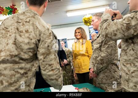 U.S. First Lady Melania Trump greets U.S. service members during a surprise visit with President Donald Trump to Al Asad Air Base December 26, 2018 in Al Anbar, Iraq. The president and the first lady spent about three hours on Boxing Day at Al Asad, located in western Iraq, their first trip to visit troops overseas since taking office. - Stock Image