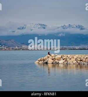 a girl sitting alone near Van Lake, Turkey - Stock Image