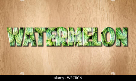 Watermelon word covered in watermelon texture on a kitchen cutting board - Stock Image