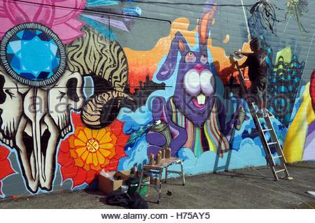Authorised street artist at work, on 10th Street in Portland, Oregon, USA. - Stock Image
