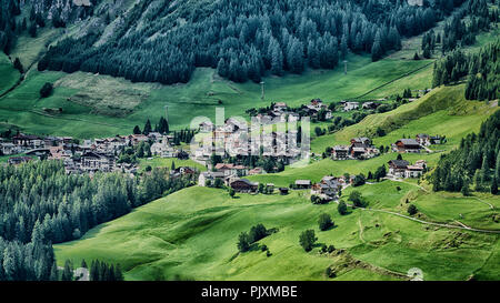 Little village of Colfosco on the hills with green meadow in summer season, Alta Badia - Trentino-Alto Adige, Italy - Stock Image
