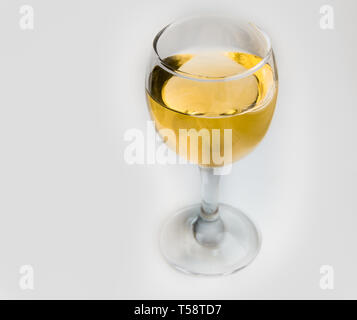 White wine in glass glass on white background. - Stock Image