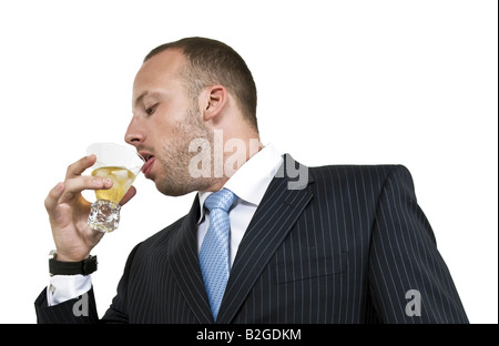 businessman drinking on isolated background - Stock Image