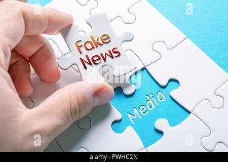 The Words Fake News And Media In Missing Piece Jigsaw Puzzle - Stock Image