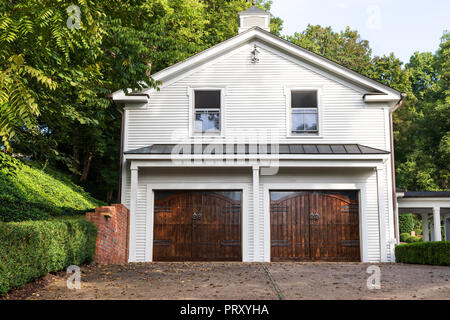JONESBOROUGH, TN, USA-9/29/18:  A two-story, two-car garage with a portico on the right . - Stock Image