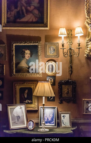 Pictures and photographs in an old fashioned stately home. - Stock Image