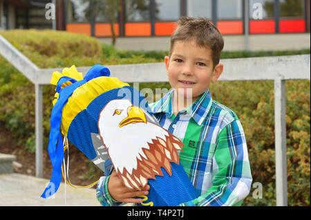 Boy, 6 years, first day at school with school cone, portrait, Germany - Stock Image