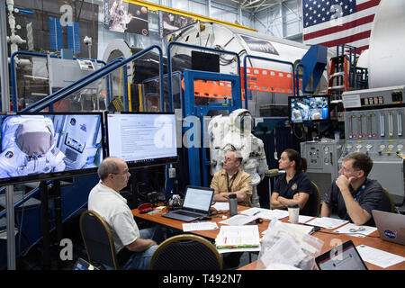 Commercial Crew Program astronauts Nicole Mann, center, Boeing Astronaut Chris Ferguson, right, and Mike Fincke, left, review training materials inside the ISS EVA PrepPost 1 training simulator for future spacewalks while onboard the International Space Station at the Johnson Space Center February 6, 2019 in Houston, Texas. - Stock Image