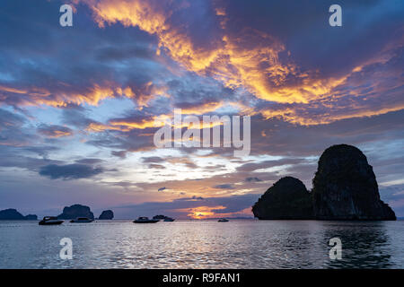 Beautiful sea sunset with cloudy sky and islands. Krabi province, Thailand, Railay or Phranang beach - Stock Image