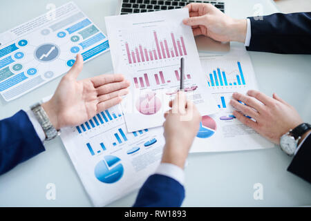 Economists discussing papers - Stock Image