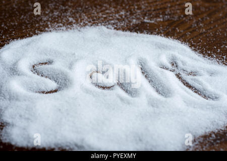 salt on wooden background - Stock Image