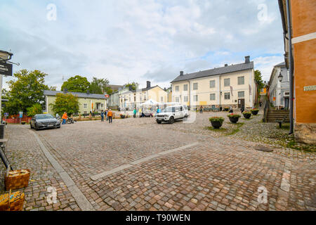Tourists and local Finns begin to set up market stalls in the town square in front of the Porvoo Museum in the medievla village of Porvoo, Finland - Stock Image