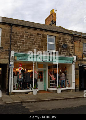 Raggy Dolls clothes shop Amble  Amble is a small town on the north east coast of Northumberland in North East England. It was a former mining town. - Stock Image