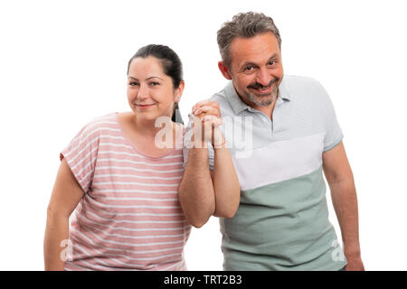 Man and woman couple holding hands as cute gesture isolated on white studio background - Stock Image