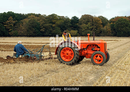 Case Model L tractor paired with a Ransome's plough at a ploughing match in Norfolk, England. - Stock Image