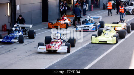 Historic Formula 2 Cars form up in the Pit Lane, before their parade lap, during the 2019 Silverstone Classic Media Day - Stock Image