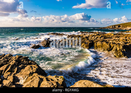 Breaking waves and surf in a cove at Fistral Beach, Newquay, Cornwall, UK - Stock Image