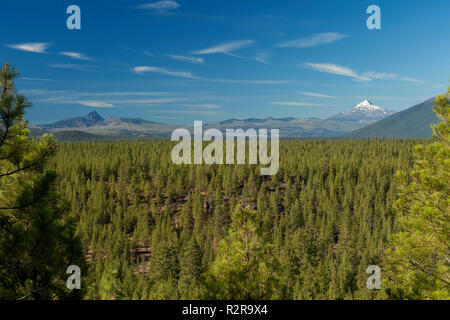 Oregon's Three Fingered Jack, a lava plug (left) and Mount Jefferson, a stratovolcano (right) as seen from the Three Creeks area near Sisters, Oregon - Stock Image