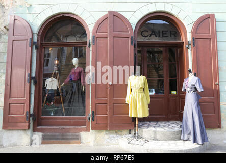 Gorgeous clothes and fabric store Caier on Strada Avram Iancu in the Old Town of Sibiu, in Transylvania, Romania - Stock Image