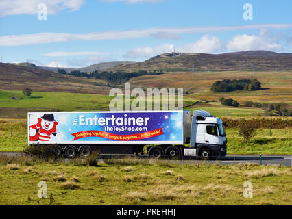 The Entertainer The Toy Shop.com  HGV. Delivering toys full of magic and surprises..Nationwide!  M6 Northbound carriageway, Shap, Cumbria, England. - Stock Image