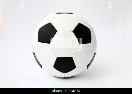 Classic black and white unbranded Football or Soccer ball. - Stock Image