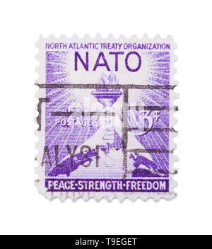 Old Nato Postage Stamp Isolated on White Background. - Stock Image