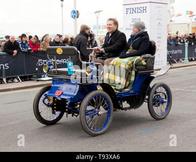 Mr Jos Van Genugten, driving a 1901, De Dion Bouton, across the finishing line, during the 2018 London to Brighton Veteran Car Run - Stock Image