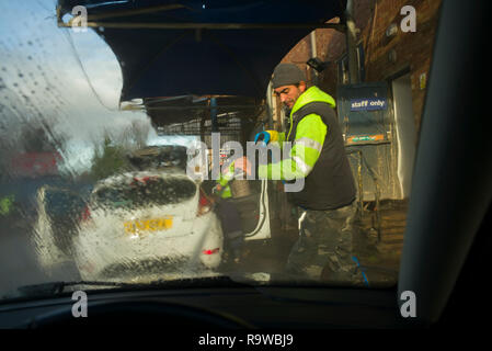Car Wash in Saffron Walden Essex England UK. December 2018 Men from Moldava and Romania washing cars. - Stock Image