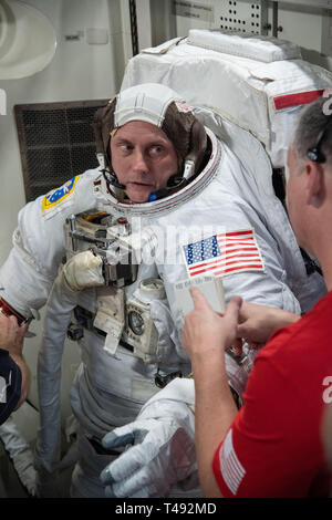 Commercial Crew Program astronaut Mike Fincke, is assisted with his spacesuit during Quest Airlock simulation for ISS EVA training in preparation for future spacewalks while onboard the International Space Station at the Johnson Space Center February 6, 2019 in Houston, Texas. - Stock Image