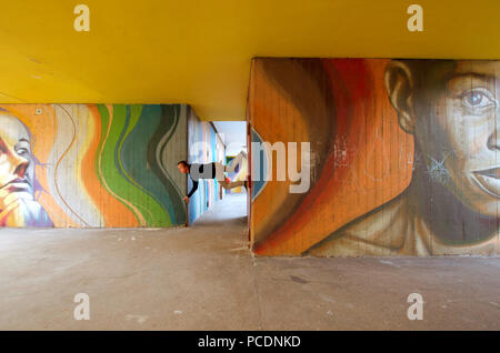 man,climbing,house wall - Stock Image