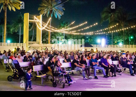 Miami Beach Florida North Beach Bandshell Beethoven on the Beach free classical music concert community orchestra audience listening Hispanic families - Stock Image
