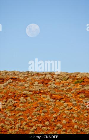 Moon rising over the desert. Australia. - Stock Image