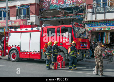 Fire truck call-out in a city street in Tsetang, Tibet, China - Stock Image