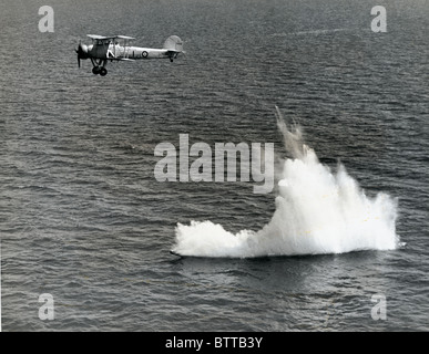 Aerial Torpedo entering the water after being launched by a Fairey Swordfish aircraft of the Fleet Air Arm - Stock Image