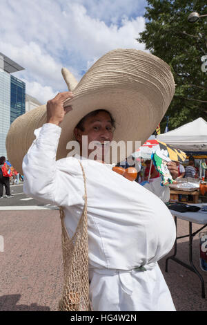 Hispanic man in big belly (fat belly) costume at an outdoor event - USA - Stock Image