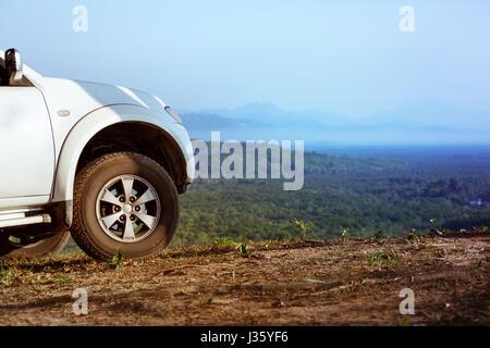 4x4 car on mountains valley backdrop - Stock Image