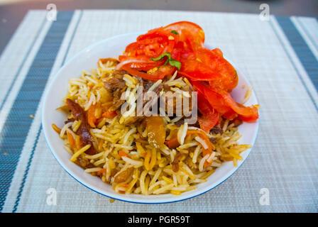 Plov, with spicy tomato salad, restaurant Maja, Kalnciema kvartals, Riga, Latvia - Stock Image
