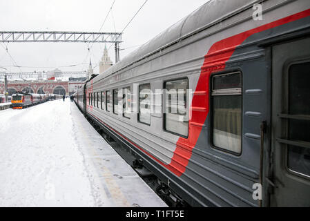 Arrival passenger train to winter train station - Stock Image