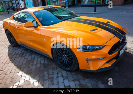 A 2018 registered orange and black Ford Mustang 5.0 sports  car in North Yorkshire England UK - Stock Image