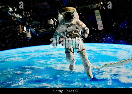 Close up view of astronaut in spacesuit, outside space station over Earth on Samsung 'The Wall' MicroLED TV, exhibit booth at CES, Las Vegas, NV, USA - Stock Image
