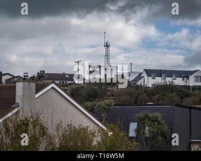 Orlock Coastguard station nestling amongst the village houses - Stock Image