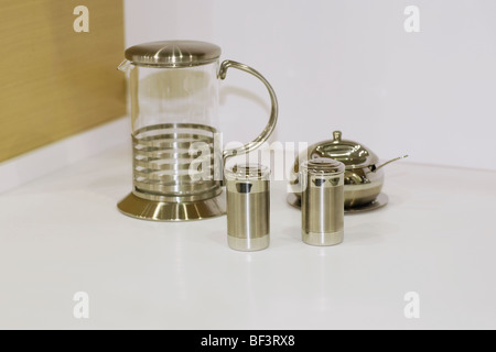 Close-up of a jug with salt shaker and pepper shaker - Stock Image