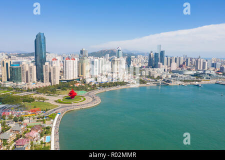 Aerial view of Qingdao cityscape  under cloudy sky - Stock Image