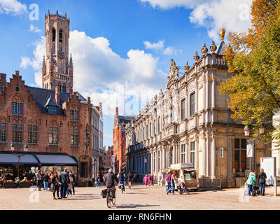 25 September 2018: Bruges, Belgium - View of the Bruges Belfry, or Belfort, from the main square of the city, the Burg. The area is crowded with touri - Stock Image